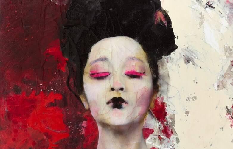 Konstverk med ett kvinnoansikte mot röd och vit bakgrund.