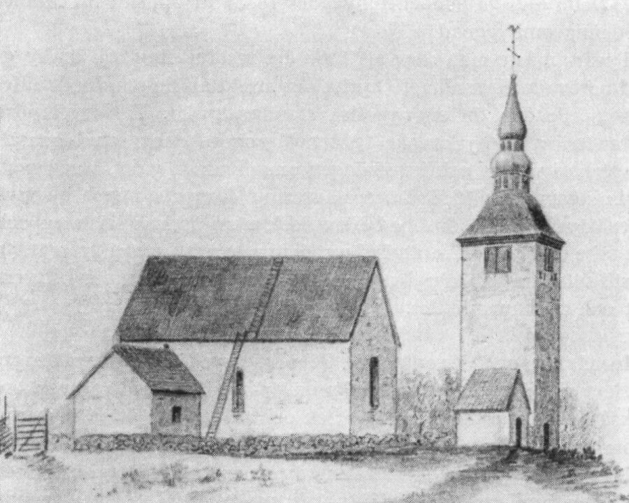 Ett fotografi av en gammal stenkyrka med torn framför.