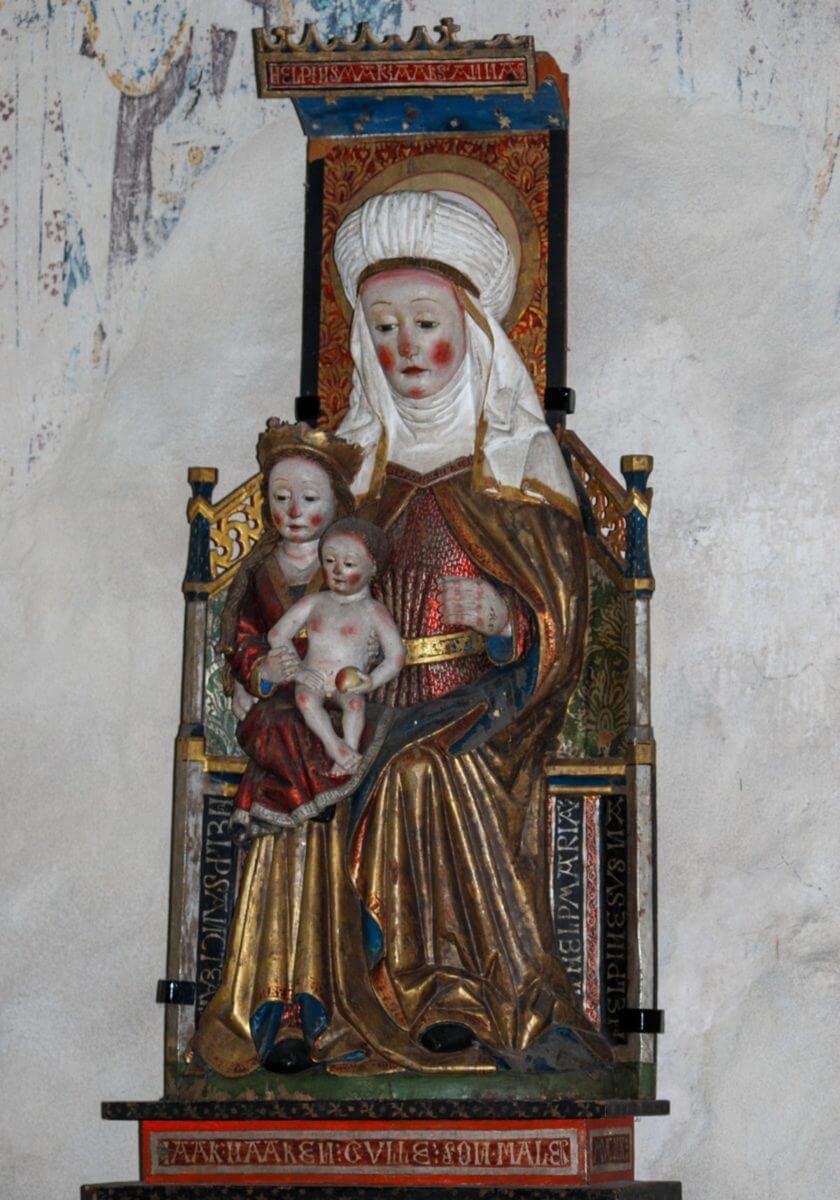 Träskulptur föreställande motivet Anna själv tredje.